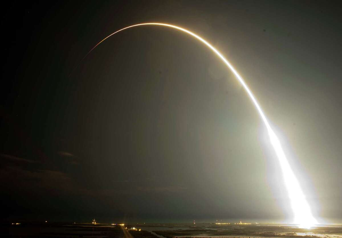 The Falcon 9 SpaceX rocket is seen during a time exposure as it lifts off from space launch complex 40 at the Cape Canaveral Air Force Station in Cape Canaveral, Fla., early Tuesday. This launch marks the first time, a private company sends its own rocket to deliver supplies to the International Space Station.(AP Photo/John Raoux)