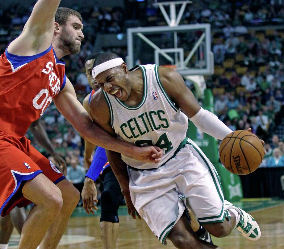 Boston Celtics' Paul Pierce, right, tries to drive past Philadelphia 76ers defender Spencer Hawes, left, during the first quarter of Game 5 in their NBA basketball Eastern Conference semifinal playoff series in Boston, Monday, May 21, 2012. The Celtics won 101-85 to take a 3-2 series lead. (AP Photo/Charles Krupa) Photo: Charles Krupa, Associated Press / AP
