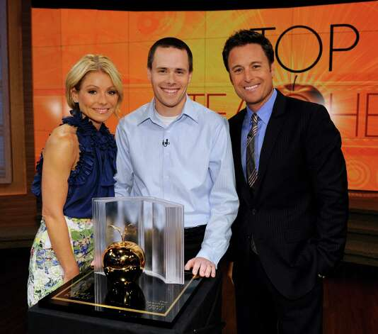 "Clifton Park teacher Bryan Sawyer, center, with television show hosts Kelly Ripa, left, and Chris Harrison. Sawyer was chosen as the top teacher on the television show ""Live! With Kelly"" on May 22, 2012. (Disney-ABC Domestic TV/Donna Svennevik) Photo: Donna Svennevik / ©2012 Disney-ABC Domestic Television.  All rights reserved. NO ARCHIVING. NO RESALE."