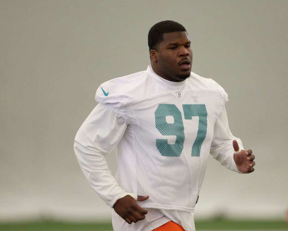 Kheeston Randall runs drills against a tackling dummy during the Miami Dolphins Rookies football camp in Davie, Fla., Friday, May 4, 2012. (AP Photo/J Pat Carter) Photo: (AP Photo/J Pat Carter), STF / AP2012