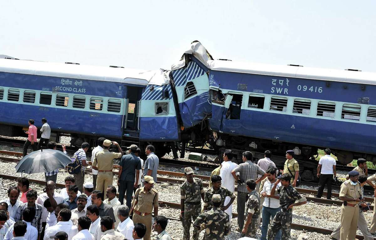 Railway officials and onlookers look at the mangled remains of the Bangalore-bound Hampi Express after it collided with a stationary goods train near Penneconda town in Ananthpur District, about 145 kms from Bangalore on May 22, 2012. At least 19 people were killed and 36 injured when a passenger train slammed into a stationary goods train in southern India, a local railway official told AFP. TOPSHOTS AFP PHOTO/Manjunath KIRANManjunath Kiran/AFP/GettyImages