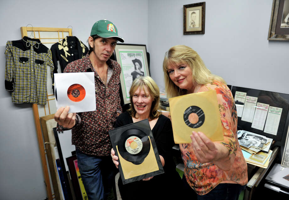Musician Jeff Smith, from left, writer/historian Margaret Moser and music fan Michael Ann Coker are organizing memorabilia for the South Texas Popular Culture Center, which opens Friday. Photo: Robin Jerstad