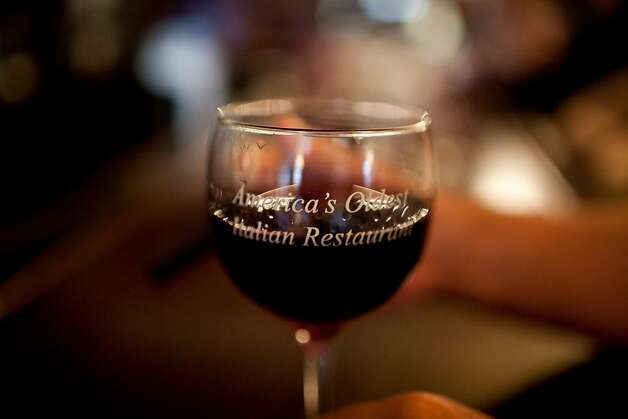 "A wine glass reads ""America's oldest Italian Restaurant"" at Fior D'Italia restaurant in San Francisco, Calif., May 21, 2012.   Jason Henry/Special to The Chronicle Photo: Jason Henry, Special To The Chronicle"