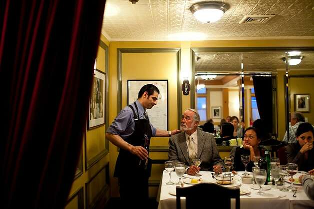 Lalo Flores, a server for 15 years, waits on patrons Gordon Bowman-Jones, whose been coming here for 30 years, and his wife Christina at Fior D'Italia restaurant in San Francisco, Calif., May 21, 2012.Jason Henry/Special to The Chronicle Photo: Jason Henry, Special To The Chronicle