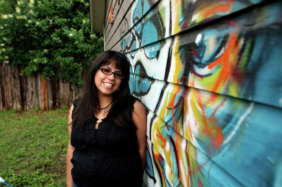 Adriana Garcia is a painter who completed a major mural for San Anto, recently had a one-woman show at R Gallery, and today teaches art at the International Academy of Art and Design.  Photo: HELEN L. MONTOYA, San Antonio Express-News / ©SAN ANTONIO EXPRESS-NEWS