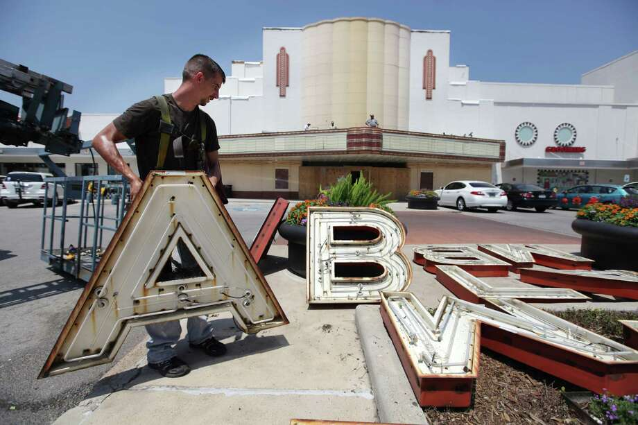 John Otto, of Coast Graphics & Signs, places the letter with the rest of the Alabama Theater Sign to begin the restoration process on Tuesday, May 22, 2012, in Houston.  A Trader Joe's will be opening inside the Alabama Theater, a city landmark, and changes suggested by the corporation were approved by the Houston Archeological and Historical Commission. Photo: Mayra Beltran, Houston Chronicle / Houston Chronicle