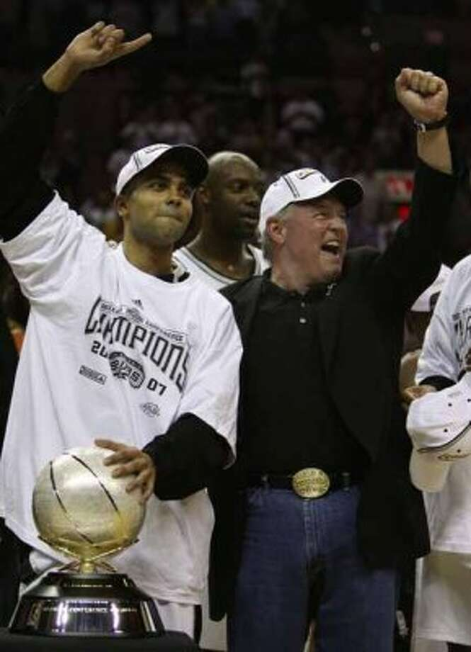 Spurs' guard Tony Parker, of France, (09) and chairman and CEO Peter Holt celebrate the Spurs Western Conference championship in San Antonio Wednesday May 30, 2007.  (EDWARD A ORNELAS/STAFF) (SAN ANTONIO EXPRESS-NEWS)