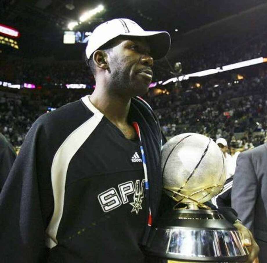 Spurs' Michael Finley walks off the court carrying the Western Conference Championship trophy after the Spurs defeated the Utah Jazz 109-84 n the Western Conference Finals game five in San Antonio Wednesday May 30, 2007.  The Spurs adavnce to their fourth NBA Finals and Finley's first of his 12-year career. (EDWARD A ORNELAS/STAFF) (SAN ANTONIO EXPRESS-NEWS)