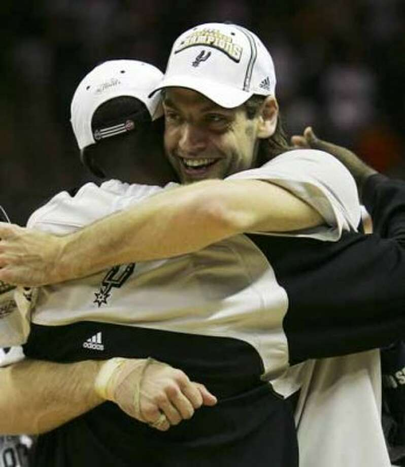 Spurs' Fabricio Oberto, facing camera, and Michael Finley embrace in celebration after they defeated the Utah Jazz 109-84  in the Western Conference Finals game five in San Antonio Wednesday May 30, 2007.  (JERRY LARA/STAFF) (SAN ANTONIO EXPRESS-NEWS)