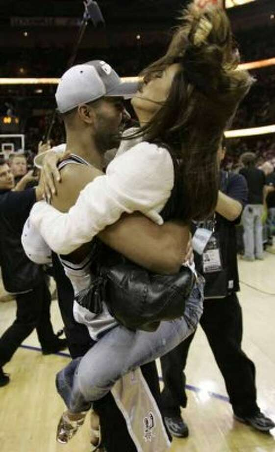 Actress Eva Longoria, right, jumps in the arms of San Antonio Spurs' Tony Parker, from France, after the Spurs won the NBA Championship in Game 4 of the NBA basketball finals Thursday, June 14, 2007, in Cleveland. The Spurs defeated the Cavaliers, 83-82, to win the series in four games. (AP Photo/Eric Gay) (AP)
