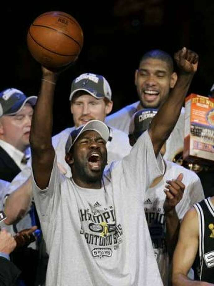 San Antonio Spurs' Michael Finley holds the game ball after the Spurs beat the Cleveland Cavaliers, 83-82, to win the NBA Championship, Thursday, June 14, 2007, in Cleveland. (AP Photo/Amy Sancetta) (AP)