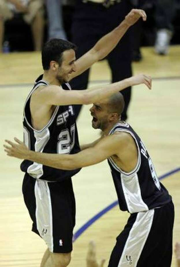 Spurs' guard Manu Ginobili, of Argentina, (20) and guard Tony Parker, of France, (09) celebrate their NBA championship after winning NBA Finals game four in Cleveland June 14, 2007.  (BAHRAM MARK SOBHANI/STAFF) (SAN ANTONIO EXPRESS-NEWS)