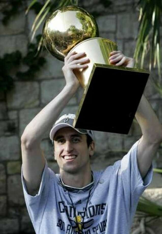 San Antonio Spurs guard Manu Ginobili, of Argentina, holds the Larry O'Brien Championship Trophy as he and teammates  take part in a river parade to celebrate winning the NBA Basketball Championship,  in San Antonio, Sunday, June 17, 2007.  (AP Photo/Eric Gay) (AP)