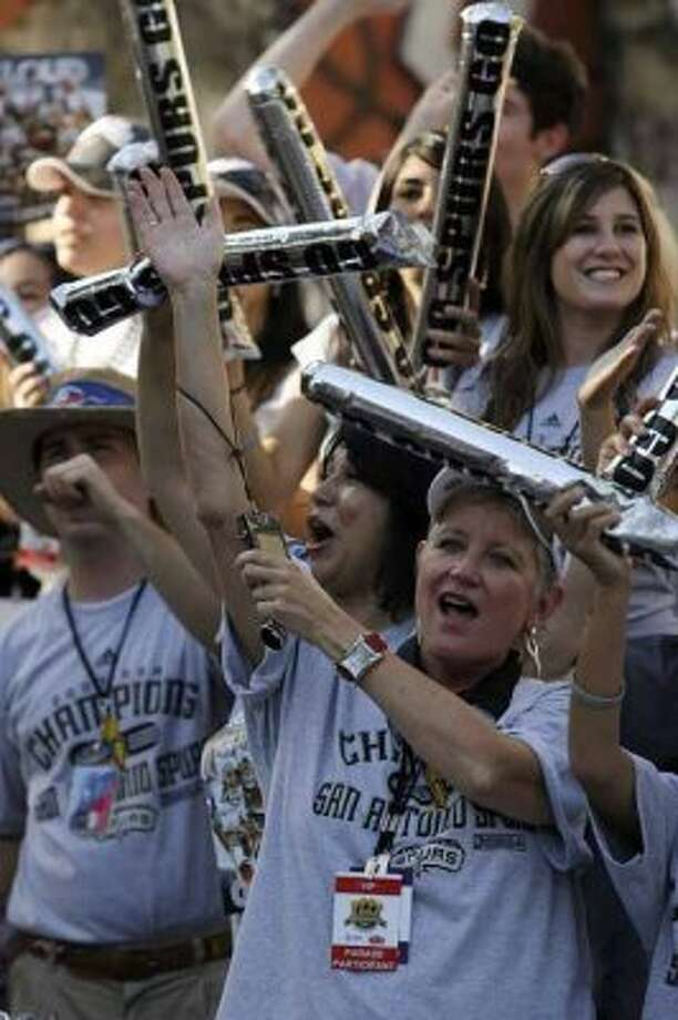 Bexar County District Attorney Susan Reed celebrates as rides in one of the floats in San Antonio Spurs parade down the Riverwalk in celebration of their fourth NBA Championship title on Sunday, June, 17, 2007.  ( JERRY LARA STAFF ) (SAN ANTONIO EXPRESS-NEWS)