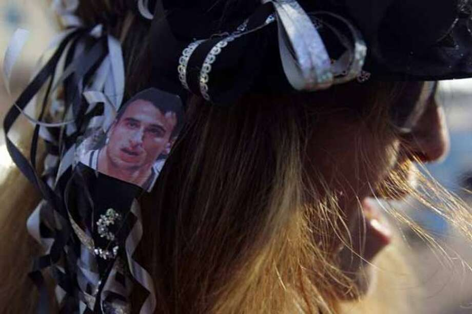 Diane Romero sports a picture of Manu Ginobili during the San Antonio Spurs celebration of their fourth NBA Championship title on Sunday, June, 17, 2007.  She was outside the Alamodome. ( JERRY LARA STAFF ) (SAN ANTONIO EXPRESS-NEWS)