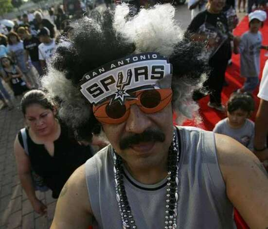 Carlos Lama waits to enter the Alamodome during the San Antonio Spurs celebration of their fourth NBA Championship title on Sunday, June, 17, 2007.  ( JERRY LARA STAFF ) (SAN ANTONIO EXPRESS-NEWS)
