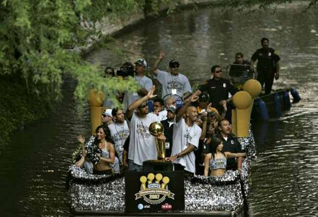 METRO - Tim Duncan and Bruce Bowen wave to adoring fans as they ride in the Spurs Championship Parade Sunday, June 17, 2007 on the San Antonio River. BAHRAM MARK SOBHANI/STAFF (SAN ANTONIO EXPRESS NEWS)