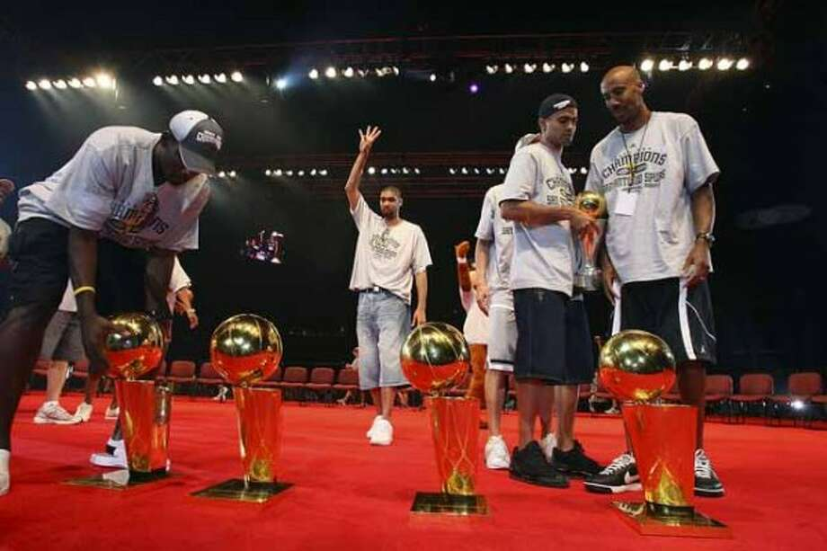 San Antonio Spurs Tim Duncan, center, celebrates along with teammates, Michael Finley, left, Tony Parker and Bruce Bowen at the Alamodome on Sunday, June, 17, 2007. The team was celebrating their fourth NBA Championship title.  ( EDWARD A. ORNELAS  STAFF ) (SAN ANTONIO EXPRESS-NEWS)