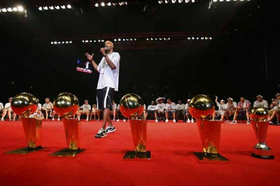 San Antonio Spurs Bruce Bowen emcees the night in front of the four Larry O'Brien Championship torphies as they celebrate their fourth NBA Championship title at the Alamodome on Sunday, June, 17, 2007.  ( EDWARD A. ORNELAS  STAFF ) (SAN ANTONIO EXPRESS-NEWS)