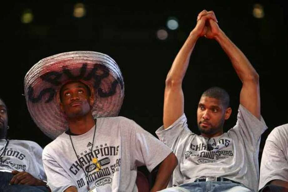 San Antonio Spurs Melvin Ely, left, wears a sombrero as he sits nexto to Tim Duncan during the team's celebration of their fourth NBA Championship title at the Alamodome on Sunday, June, 17, 2007.  ( EDWARD A. ORNELAS STAFF ) (SAN ANTONIO EXPRESS-NEWS)