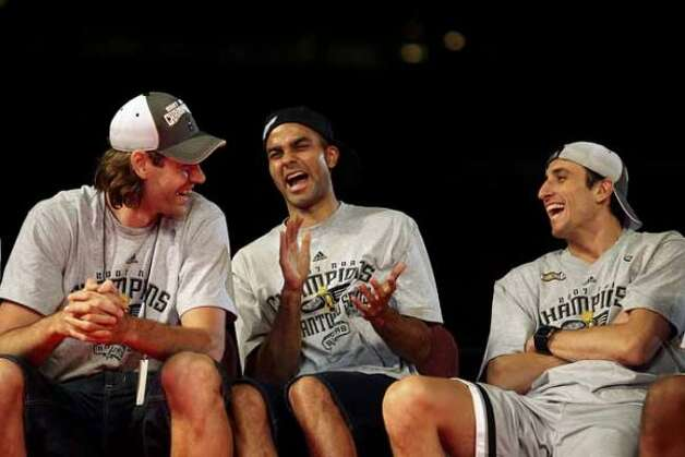 San Antonio Spurs from left, Fabricio Oberto, Tony Parker and Manu Ginobili share a laugh on stage as they celebrate the team's fourth NBA Championship title at the Alamodome on Sunday, June, 17, 2007.  ( EDWARD A. ORNELAS STAFF ) (SAN ANTONIO EXPRESS-NEWS)