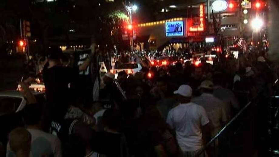"MULTIMEDIA 37266 - San Antonio residents flooded the streets of downtown San Antonio to celebrate the Spurs' fourth NPA Championship win. They clogged the streets honking horns, ran up and down Commerce screaming and chanting ""Go Spurs Go."" (SAN ANTONIO EXPRESS-NEWS)"