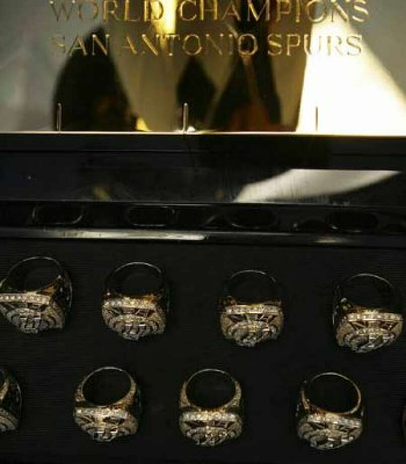 SPORTS - The Spurs 2007 Championship rings are displayed next to the Larry O'Brien Trophy Tuesday, October 30, 2007 at the AT&T Center prior to the start of the season opener against Portland. Spurs players and staff received their rings during a pre-game ceremony. BAHRAM MARK SOBHANI/STAFF (SAN ANTONIO EXPRESS NEWS)