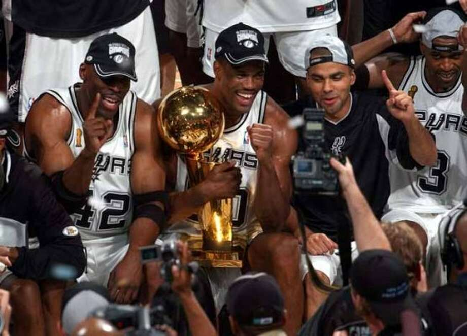 San Antonio Spurs from left, Kevin Willis, David Robinson, Tony Parker and Stephen Jackson celebrate after winning the NBA Championship  at the SBC Center in San Antonio Sunday June 15, 2003. (WILLIAM LUTHER/STAFF) (SAN ANTONIO EXPRESS-NEWS)