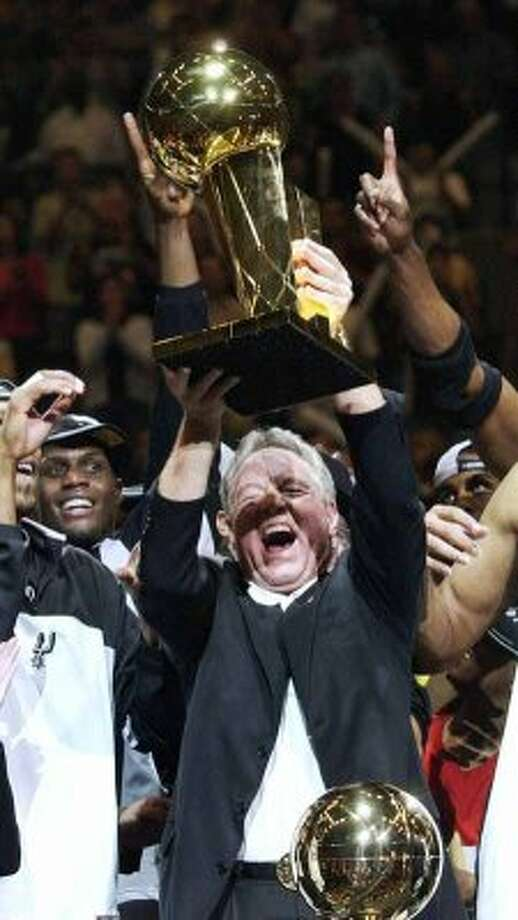 San Antonio Spurs chairman Peter Holt holds the NBA championship trophy after the Spurs beat the New Jersey Nets 88-77 in Game 6 of the NBA Finals in San Antonio, Sunday, June 15, 2003. (AP Photo/Eric Gay) (AP)
