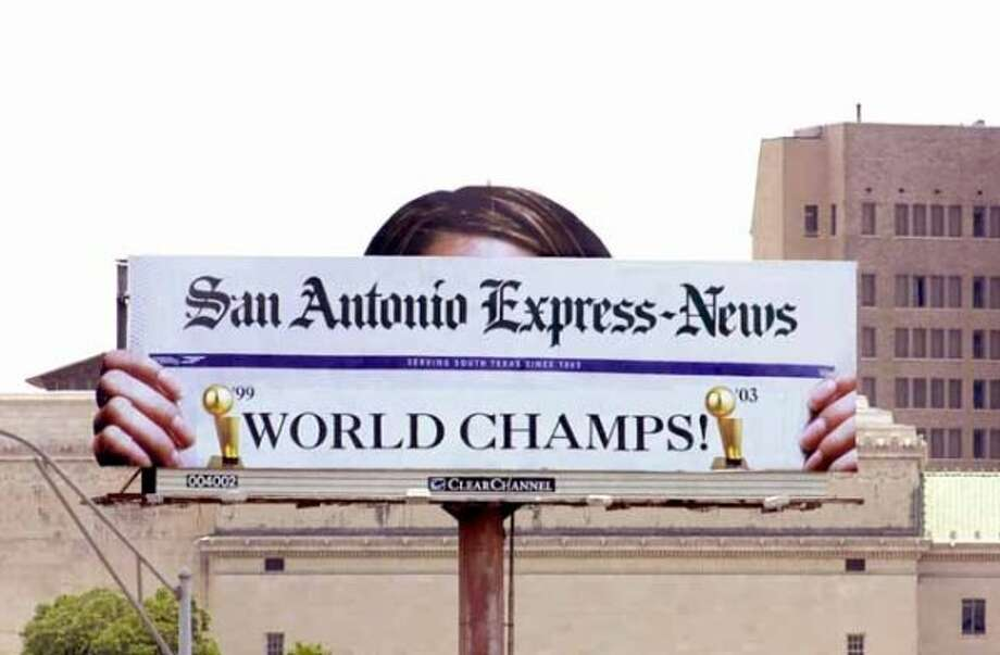 METRO: The San Antonio Express-News billboard shows that the Spurs won the NBA Championship game. (Wendi Poole/special to the EXpress-News) (SPECIAL TO THE EXPRESS-NEWS)