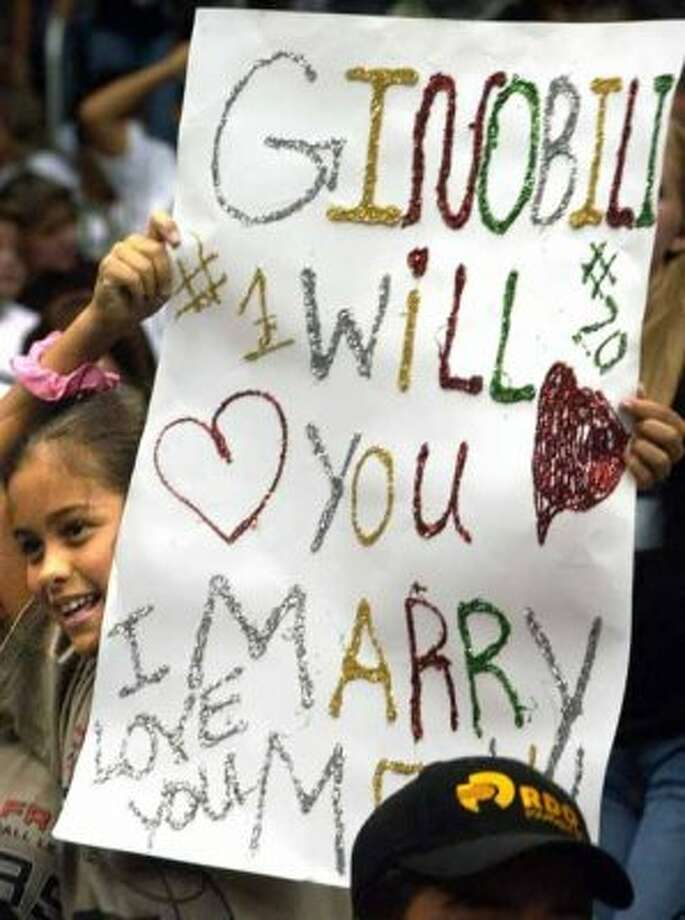 METRO - Monique Elizondo, 9, holds a sign asking Ginobili to marry her during the SBC 2003 Spurs Championship Celebration at the Alamodome,Thursday, June 18, 2003.    Tom Reel/Staff (SAN ANTONIO EXPRESS-NEWS)