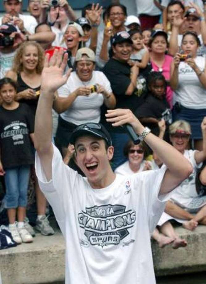 FOR METRO - Spurs' Manu Ginobili waves to fans as he makes his way through the Rivercenter lagoon during the parade Wednesday June 18, 2003.  PHOTO BY EDWARD A. ORNELAS/STAFF (SAN ANTONIO EXPRESS-NEWS)