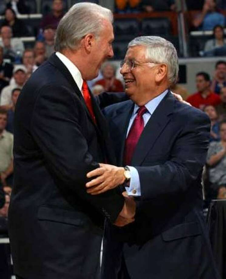 SPORTS   ---   NBA Commissioner David Stern, right, greets Spurs coach Gregg Popovich during the Spurs' championship ring ceremony Tuesday Night Oct. 28, 2003 at the SBC Center before the start of their game against the Phoenix Suns.        (WILLIAM LUTHER/STAFF) (SAN ANTONIO EXPRESS-NEWS)