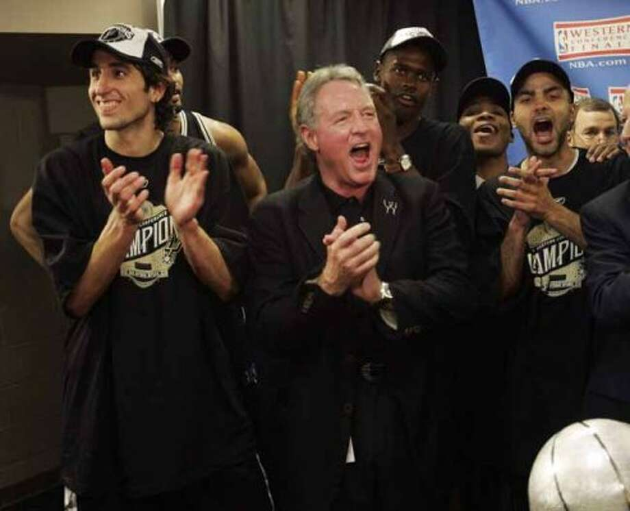 Spurs majority owner Peter Holt, second from left celebrates the Western Conference championship  with help from Manu Ginobili, left, Tony Parker, right. WILIAM LUTHER