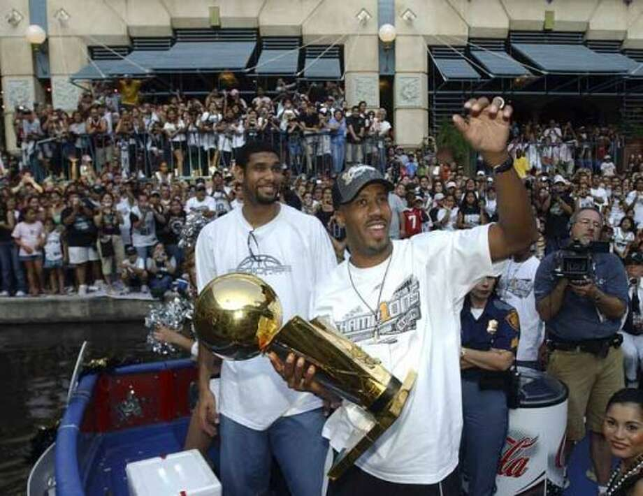 FOR METRO - Spurs' Tim Duncan and Bruce Bowen celebrate during the championship parade through the River Center Lagoon Saturday June 25, 2005. FOR PHOTO BY EDWARD A. ORNELAS (SAN ANTONIO EXPRESS-NEWS)