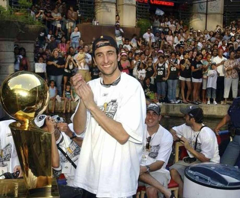 FOR METRO - Spurs' Manu Ginobili is all smiles during the championship parade through the River Center Lagoon Saturday June 25, 2005. FOR PHOTO BY EDWARD A. ORNELAS (SAN ANTONIO EXPRESS-NEWS)