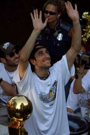 Manu Ginobili rides during Spurs NBA Championship River Parade Saturday, June 25, 2005. Nicole Fruge/San Antonio Express News (SAN ANTONIO EXPRESS-NEWS)