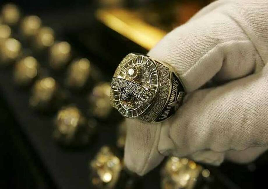 SPORTS - The San Antonio Spurs' 2005 NBA Championship rings are displayed Tuesday, November 1, 2005 at the SBC Center. BAHRAM MARK SOBHANI/STAFFSAN ANTONIO SPURSDENVER NUGGETSNBA BASKETBALLSBC CENTER (SAN ANTONIO EXPRESS NEWS)