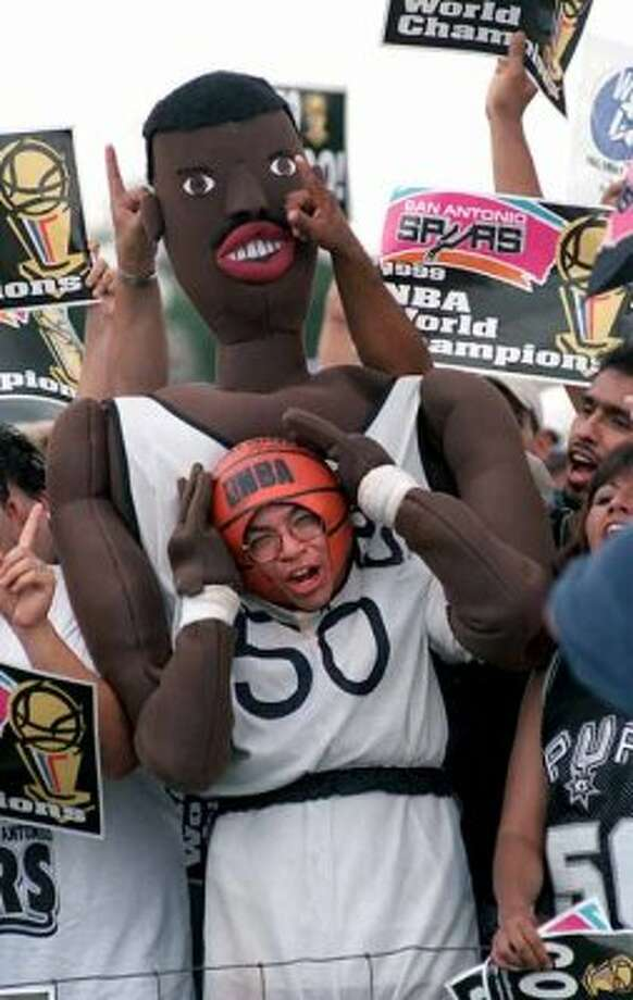 METRO - SpursÕ fan Rudy Catillo goes crazy for the World Championship team Saturday June 26, 1999 at the San Antonio International Airport while waiting for the Spurs to arrive home. The Spurs won the NBA Title 4-1 against the New York Knicks Friday night in New York. Photo by Kevin Geil