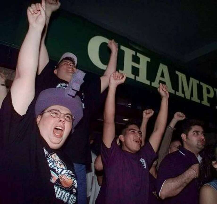 San Antonio Spurs fan Joe Dominguez, left, and friends celebrate in San Antonio as the Spurs beat the Knicks to win the NBA Championship Friday, June 25, 1999, in New York. The Spurs won 78-77. (AP Photo/Pat Sullivan) (AP)