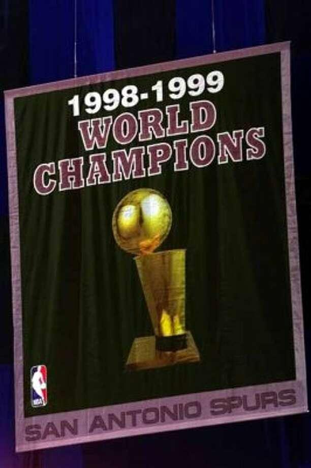 Spurs NBA Championship banner hangs in the Alamodome during ceremony honoring the team.  DELCIA LOPEZ/STAFF