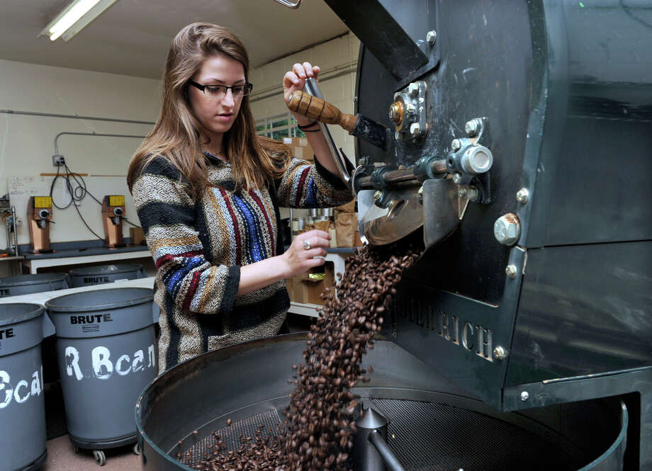 Kaitlyn Heisler, 23, roasts Kona beans from Hawaii in the small-batch roaster at  Redding Roasters Coffee Co., which her father, Bill O'Keefe, started eight years ago. Photo: Carol Kaliff