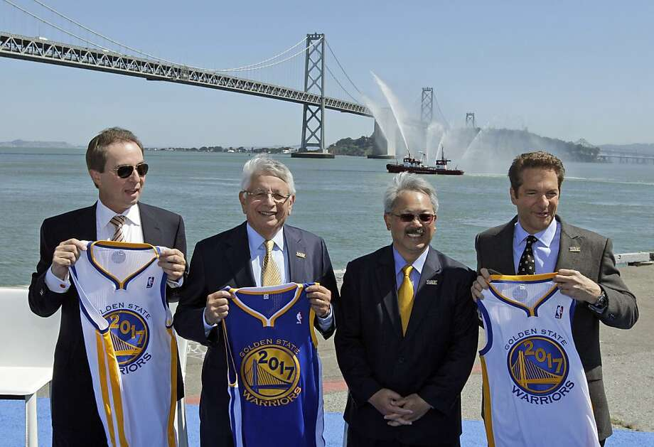 From left, Golden State Warriors owner and CEO Joe Lacob, NBA Commissioner David Stern, San Francisco Mayor Ed Lee and Warriors owner Peter Guber hold up 2017 jerseys following an announcement Tuesday, May 22, 2012, in San Francisco, that the NBA basketball team wants to build a new arena on the waterfront in San Francisco.  The Warriors unveiled plans to build an arena at Piers 30-32.  Photo: Eric Risberg, Associated Press