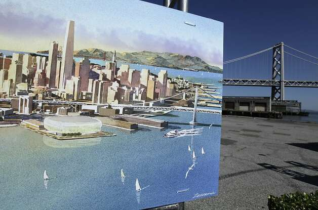 An artists sketch showing the Golden State Warriors proposed new basketball arena is displayed with the San Francisco-Oakland Bay Bridge in the background in San Francisco, Tuesday, May 22, 2012. The Warriors unveiled plans to build an arena at Piers 30-32. The waterfront site is just blocks from the San Francisco Giants' ballpark and the downtown financial district. The arena is expected to be completed by 2017. Photo: Eric Risberg, Associated Press