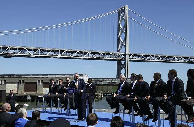 NBA commissioner David Stern, at podium, speaks during an announcement, Tuesday, May 22, 2012, in San Francisco, that the Golden State Warriors basketball team wants to build a new arena on the waterfront in San Francisco. The Warriors unveiled plans to build an arena at Piers 30-32. The waterfront site is just blocks from the San Francisco Giants' ballpark and the downtown financial district. The arena is expected to be completed by 2017. Photo: Eric Risberg, Associated Press