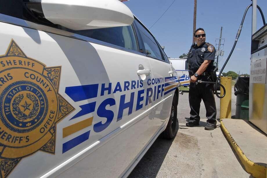 Five-year Harris County Sheriff's Office Deputy Robert DeAlejandro Jr. fills up his patrol car at the Clay Road substation. Photo: Tony Bullard / © Tony Bullard & the Houston Chronicle