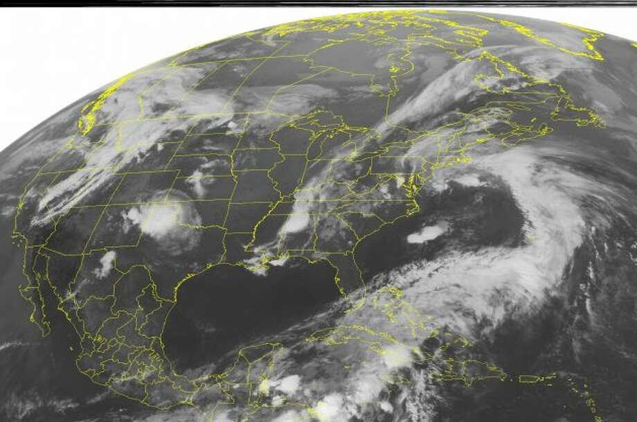 This NOAA satellite image taken Tuesday, May 22, 2012 at 1:45 a.m. EDT shows Tropical Depression Alberto located 245 miles southeast of Charleston, South Carolina. The depression is moving toward the east-northeast near 13 mph with maximum sustained winds near 35 mph, and higher gusts. Meanwhile, areas of rain and thunderstorms form in the Eastern Seaboard ahead of a cold front extending from the Lower Great Lakes through the Southeast. (AP PHOTO/WEATHER UNDERGROUND) Photo: AP / AP Photo: AP