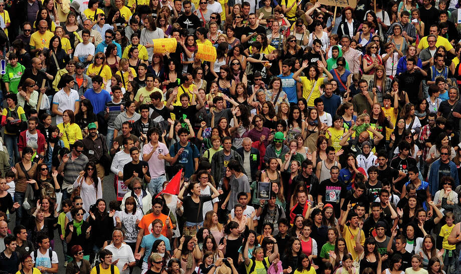 University students take part during a demonstration against education cuts in Barcelona, Spain, Tuesday May 22, 2012. Teachers at all levels of Spain's education system are on strike to protest billions in spending cuts enacted as part of an austerity drive. The billions of euros in cuts in spending translate into fewer teachers, more students per class, fewer extra-curricular activities and higher university tuition. (AP Photo/Manu Fernandez) Photo: MANU FERNANDEZ, Associated Press / AP