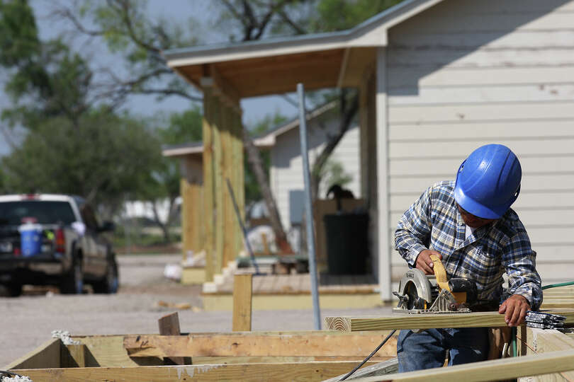 Aberlardo Rodriguez works on a unit frame at Sendero Ranch, a man camp outside Pearsall.