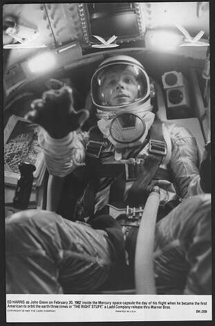 "Ed Harris as John Glenn on February 20, 1962 inside the Mercury space capsule the day of his flight when he became the first American to orbit the earth three times in ""The Right Stuff,"" a Ladd Company release thru Warner Bros. Photo: Unknown, The Ladd Company"